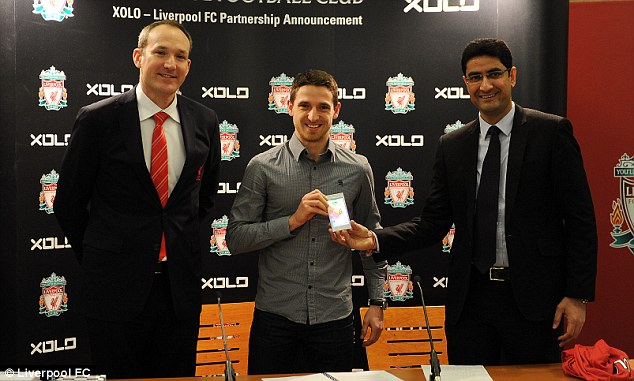 All smiles: Midfielder Joe Allen took part in a live videolink press conference to India