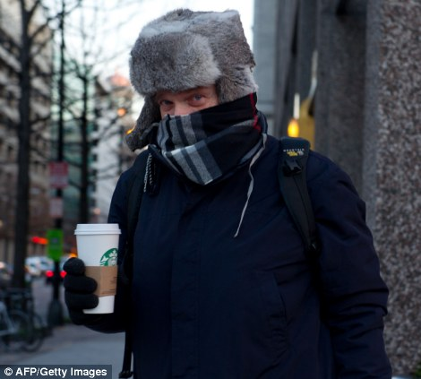 A man bundled against the cold grabs a hot coffee as temperatures dipped into the single digits on Tuesday in Washington, DC