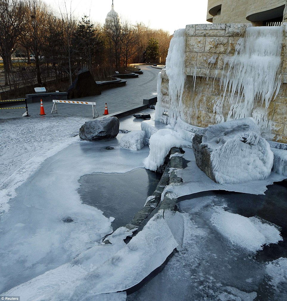 An exterior waterfall that froze overnight is seen at the National Museum of the American Indian in Washington, DC on Tuesday