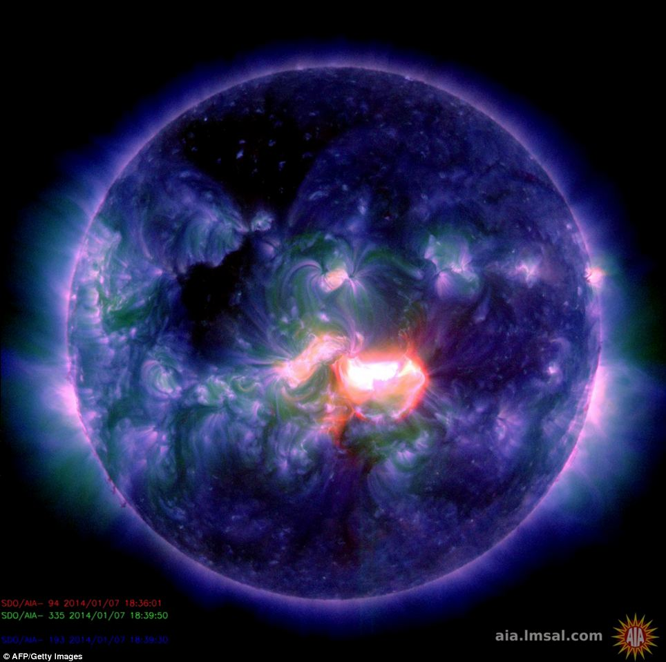 A false-colour composite image from a blast of activity originating from an active sunspot region at the centre of the sun's disk. The sun erupted with a powerful X1.2-class solar flare on Tuesday, disrupting radio traffic and sending a blast of electrically charged particles our way