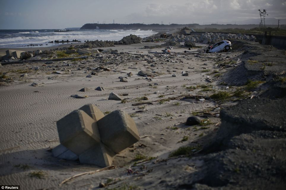 Destroyed: It has been nearly three years since tsunami waves swept these defences aside and flooded the Fukushima Daiichi plant, causing a meltdown