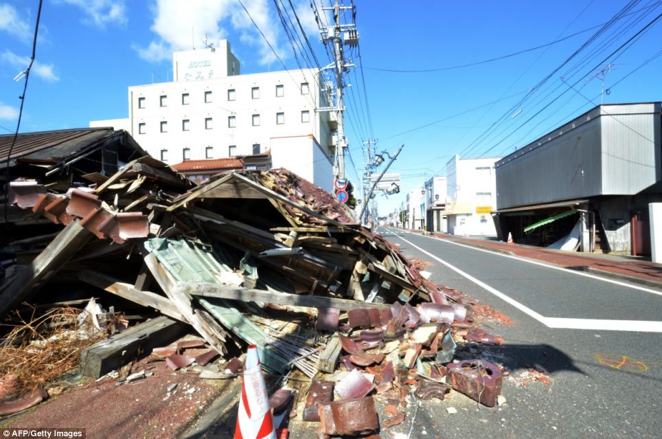 No way back: Some 22,000 former residents of Namie (pictured) are being allowed back to their homes, but can only go once a month and cannot stay overnight