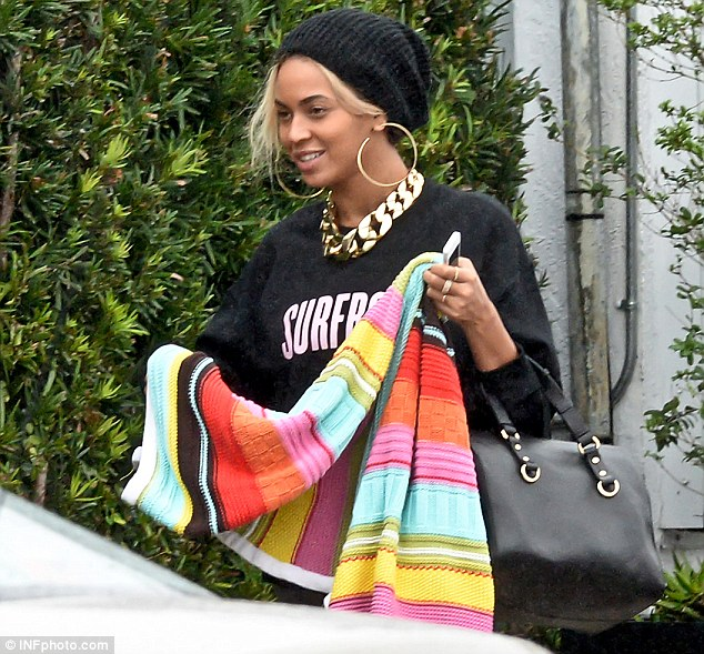 Off-duty style: Beyoncé wore the 'Surfboard' sweatshirt from her own merchandise range which is on sale on her website, the slogan is from her song Drunk In Love, she accessorised with a chunky AllSaints choker