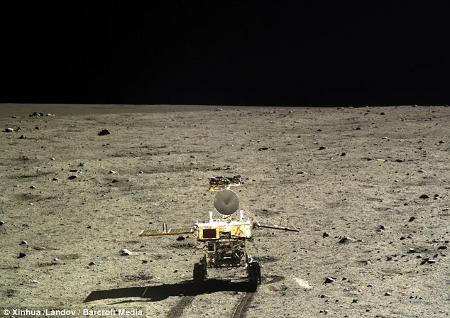 Chasing the horizon: The sky over the Moon appears inky black in this picture showing the Jade Rabbit rover trundling across the lunar surface taken from the Chang'e 3 lander and released today by Chinese scientists