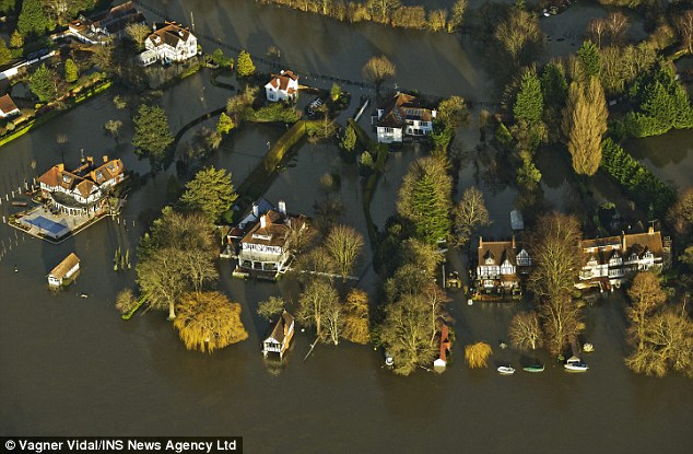 Swamped: Flooding on the River Thames last week. David Rose said the BBC followed an agenda