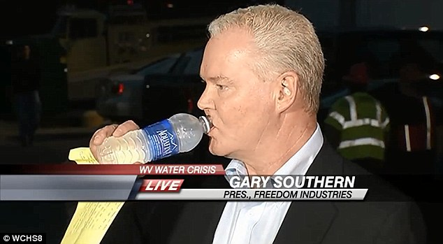 Thirsty work: Freedom Industries President Gary Southern repeatedly swigged from a water of bottle on Friday, seemingly impervious to the fact that his company had depriving 300,000 people of tap water to drink or even wash themselves