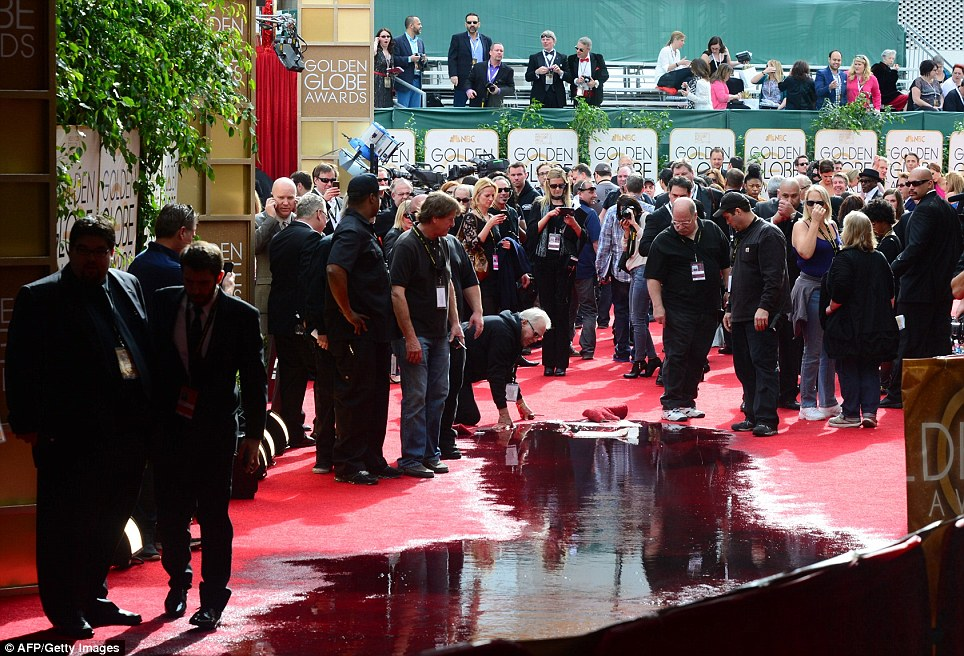 Flooded: Several hotel workers had to deal with a disastrous burst sewage pipe on the carpet