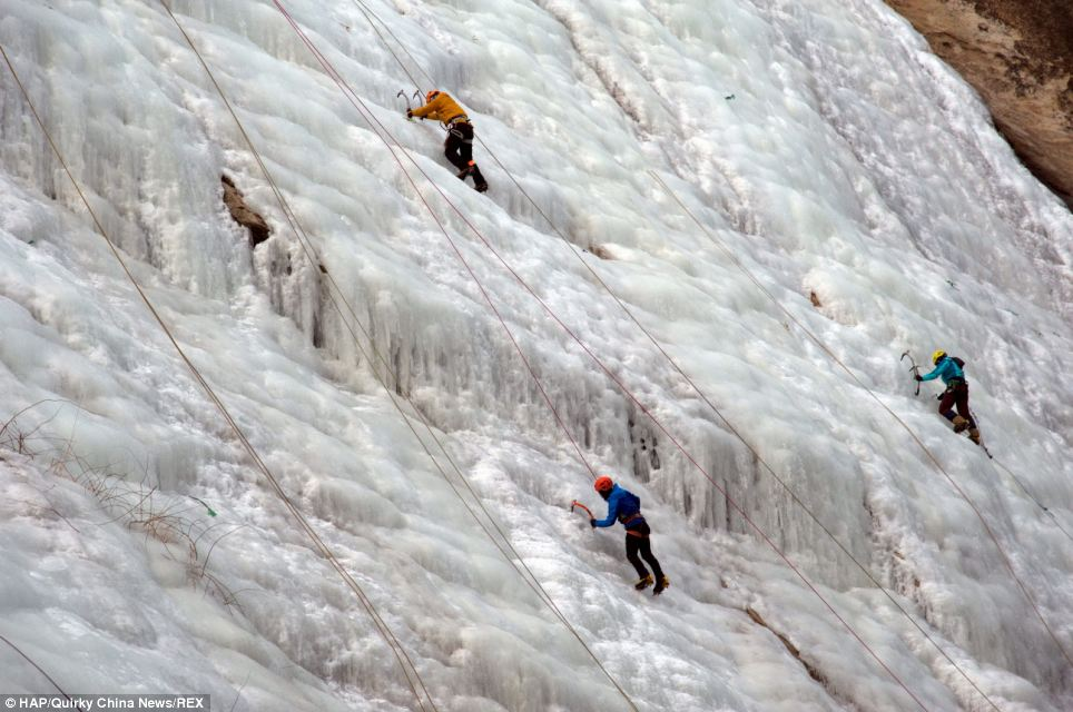 Challenge: The incredible sight has attracted dozens of climbers who armed with crampons and a pickaxes decided to scale the vast waterfall