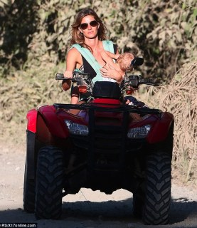 Not the most safe form of trasnsport: Gisele Bündchen rides a quad bike with her daughter Vivian in one arm, in Costa Rica