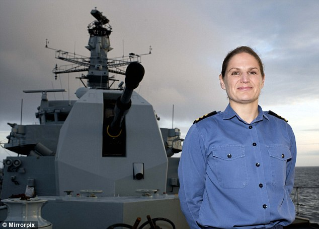 Sarah West stands proudly on HMS Portland as the Royal Navy's first female commander of a warship.