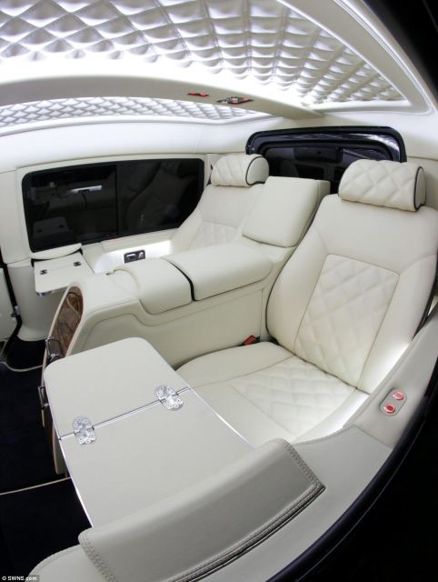 The pimped up Land Rover, which was customised by Carisma Auto Design, has swapped its classic seats for swanky, quilted adjustable chairs