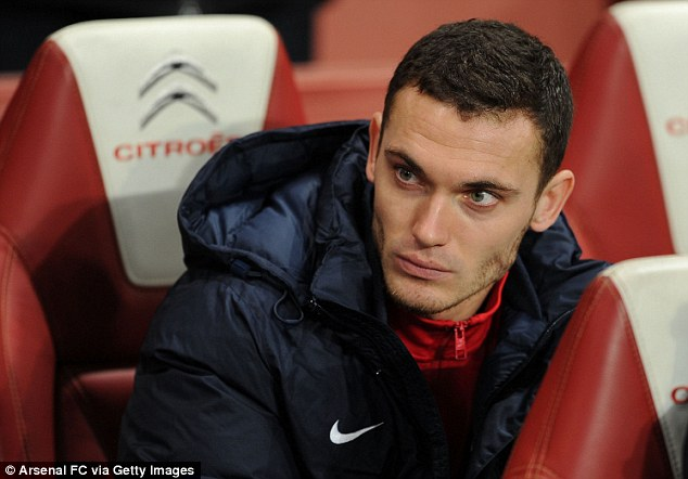 Missing out: Arsenal's club captain Thomas Vermaelen has had to make do with a place on the bench