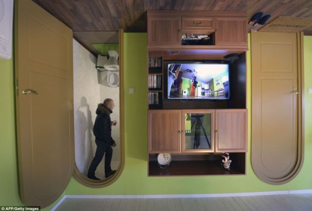 Once inside, visitors stare up in wonder at a bathroom with fittings all hanging from the ceiling and marvel at a gravity-defying garage that features a real Mini