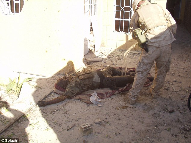 Horrific: Shocking images depicting U.S. soldiers burning the bodies of what appear to be Iraqi insurgents, have emerged today
