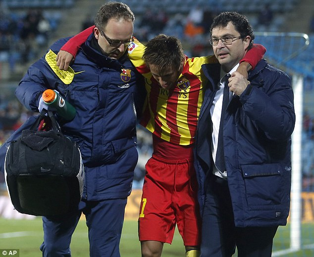 Injury blow: Neymar had to be carried off by Barcelona's medical staff as Barca won 2-0