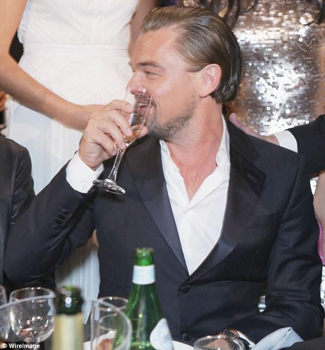 Leonardo DiCaprio Quaffs Champagne At The Critics Choice