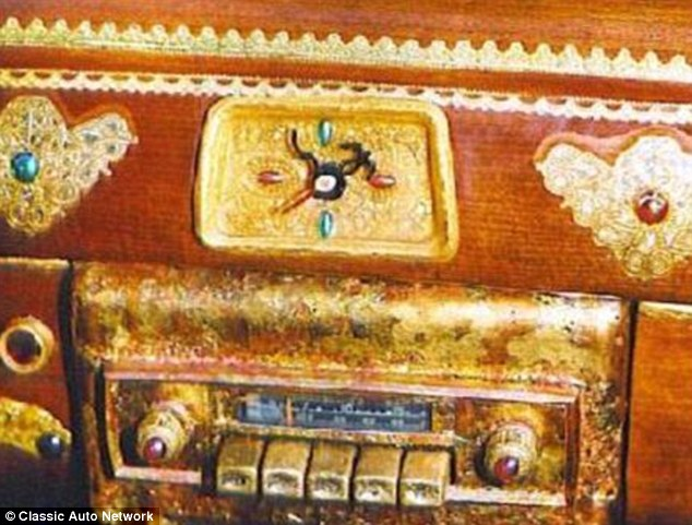 The radio is made of gold and the buttons are fitted with rubies. Emeralds can also been seen here on the dash