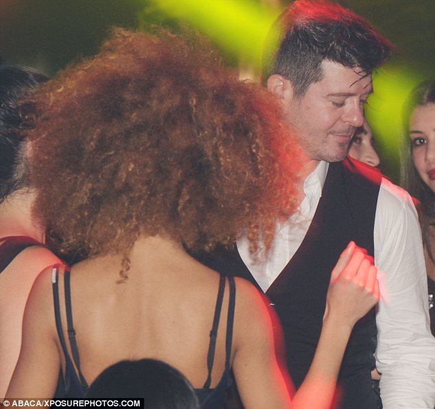 Busting a move: Robin and the beauty got up close and personal on the dancefloor at Club 79 in Paris