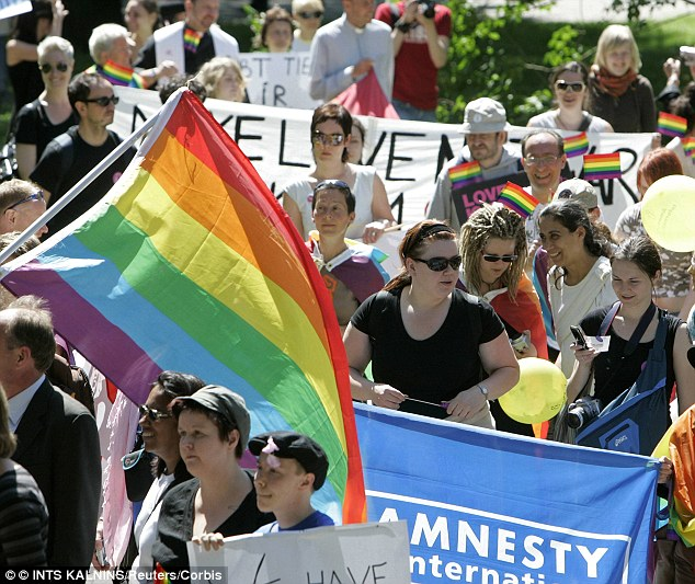 People with rainbow flags chant slogans as they attend Riga Pride 2007 in Riga, Latvia