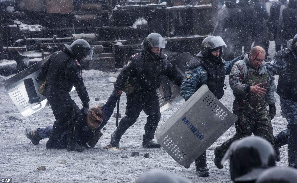 Clampdown: Police detain protesters during a clash in central Kiev, today as both sides appear unwilling to back down from violent conflict