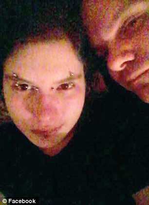 Charged: This is Jessica Burlew - who calls herself Xenia Mex on her Facebook profile. She has been charged with 2nd degree murder after allegedly strangling her 43-year-old boyfriend (Jason Ash - pictured with Jessica - right) to death