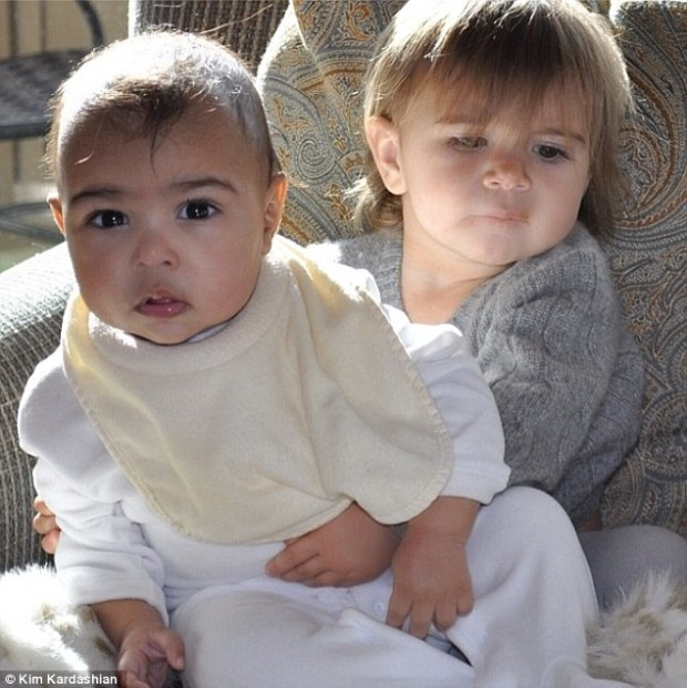 Adorable cousins: North West got a sweet hug from Penelope Disick in first social media portrait, posted by proud mother Kim Kardashian on Friday