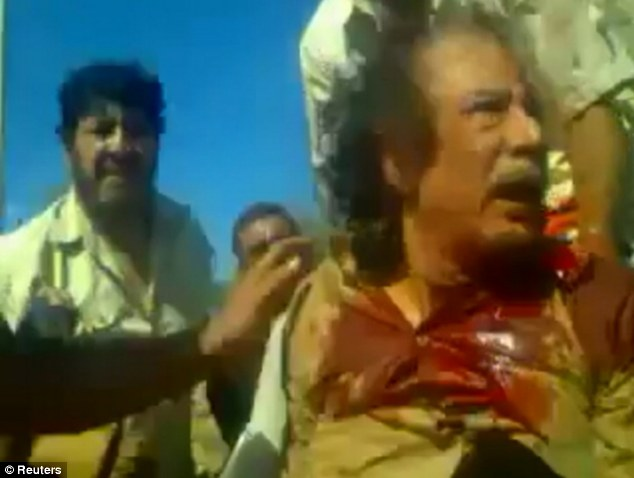 The end: After months of civil war, Muammar Gaddafi was tracked down in October 2011 and shot by freedom fighters