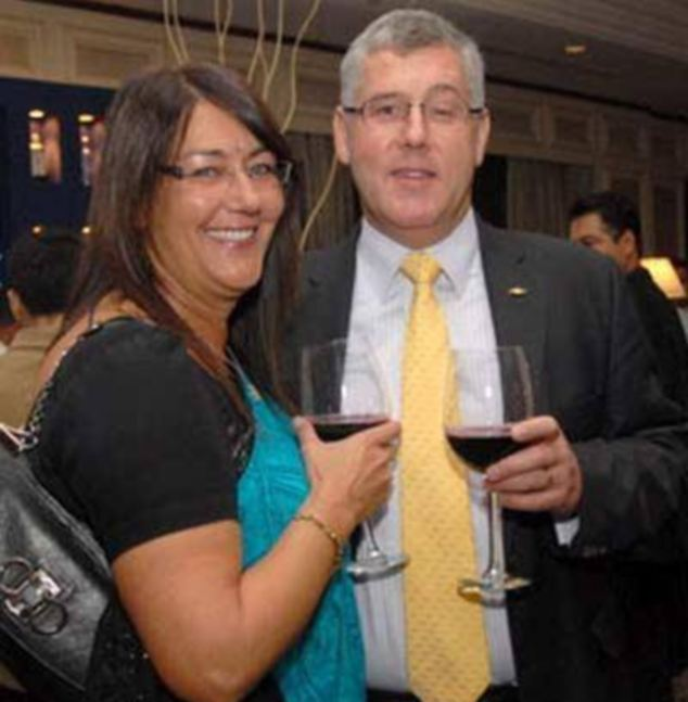Karl Slym and his wife Sally, who had travelled to Thailand with her husband, during an awards ceremony