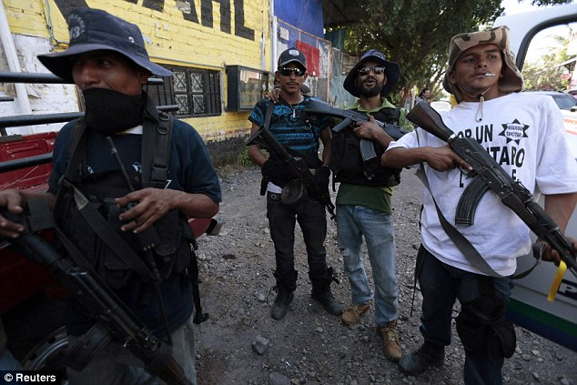 Mexican vigilantes pictured in the village of Paracuaro in Michoacan state, an impoverished agricultural state about one and a half times the size of Switzerland, where they have been battling drug cartel the Knights Templar
