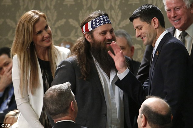 Feted guests: Duck Dynasty's Willie Robertson, center and his wife Korie, talk with Rep. Paul Ryan, R-Wis., before President Barack Obama's State of the Union address on Capitol Hill in Washington, Tuesday Jan. 28