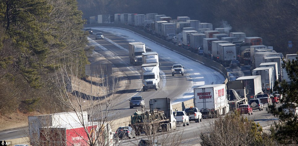 Vehicles are backed up on interstate 20 westbound on Thursday in Leeds, Alabama as icy road conditions and temperatures well below the freeing mark continued