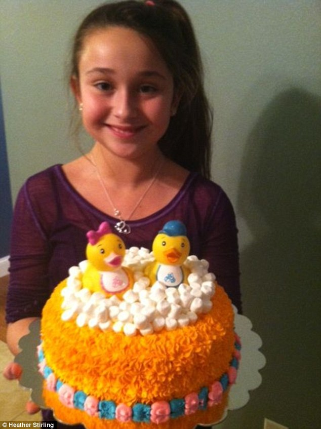 Master baker: Chloe with a cake she made for a baby shower