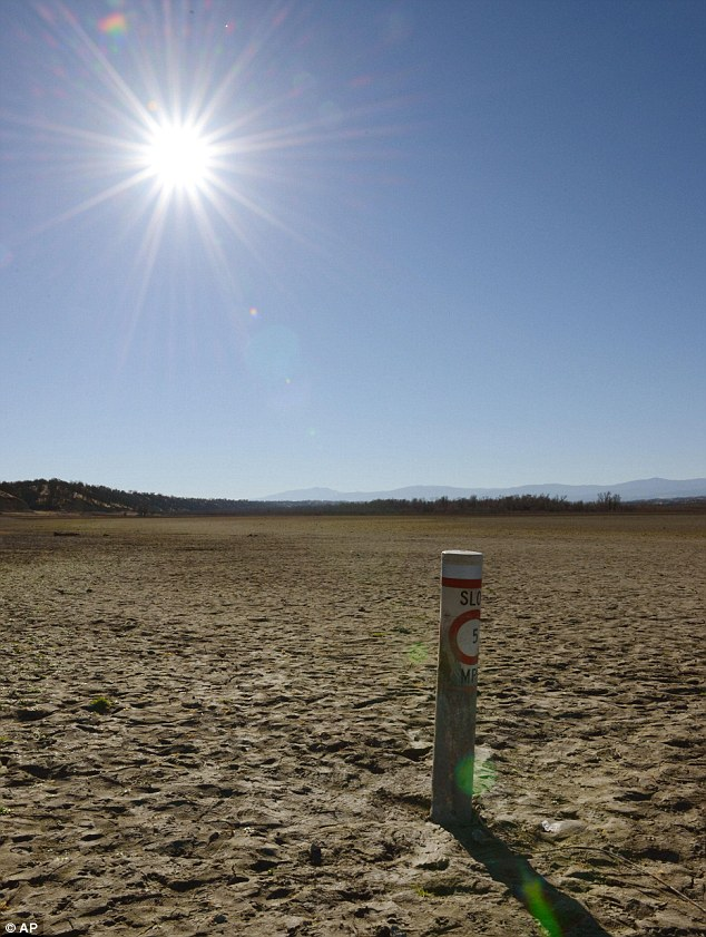 Run dry: A boating speed limit buoy stands out on the dry bed of Black Butte Lake last month