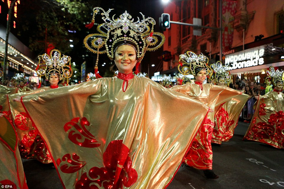 Global celebrations: More than 100,000 people came out to watch the New Year parade in Sydney's centre