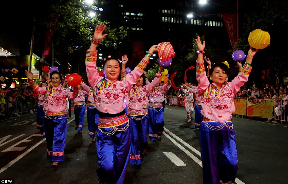 Performers in traditional dress take part in the Twilight Parade in Sydney to mark the New Year celebrations