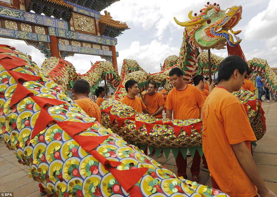 South African celebration: Members of a Nanhua Temple perform a traditional Chinese ritual with a dragon as they celebrate the Chinese New Year near Pretoria