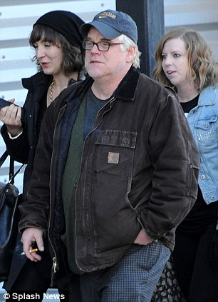 Film festival: Philip Seymour Hoffman at Sundance on January 18, with his British assistant Isabella Wing-Davey (on the actor's left in black hat) who discovered his body on Sunday in Manhattan