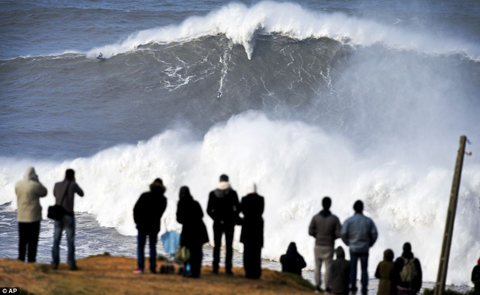 Perilous: Mr Cotton, a plumber and lifeguard when he isn't surfing, could only tackle one 80ft wave in the entire wind-battered trip to Praia do Norte beach in Portugal