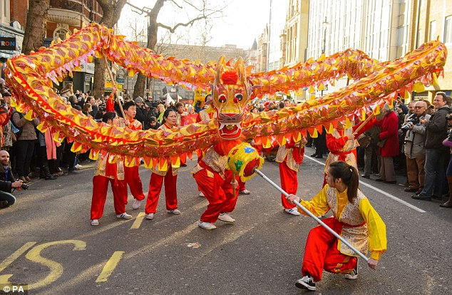 Colourful: A Chinese dragon leads the annual Chinese New Year parade through Central London yesterday
