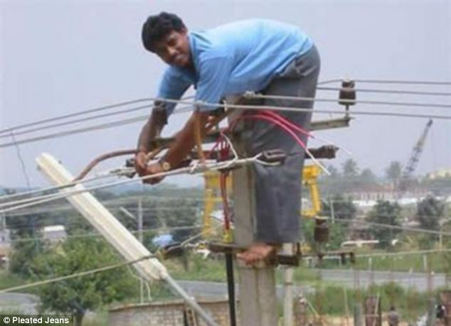 A man decides using a cherry picker is not an option and climbs a pole to fix some wiring