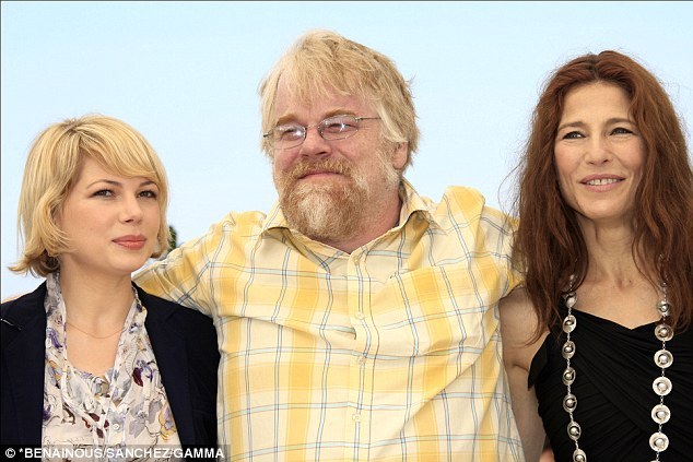 Movie role: Williams, pictured left, worked with Philip Seymour Hoffman in the 2008 film 'Synecdoche, New York' alongside Catherine Keener, right