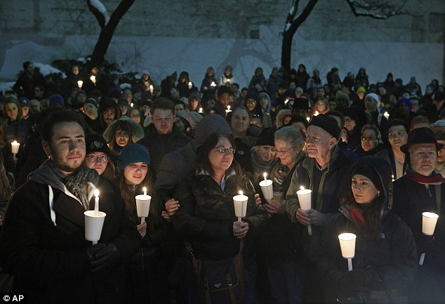 Vigil: Hundreds of people gather for a candlelight vigil for actor Philip Seymour Hoffman in the courtyard of the Bank Street Theater, home of the Labyrinth Theater Company, Wednesday