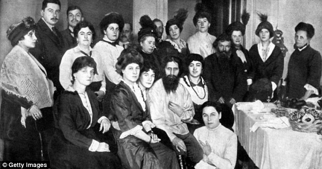 Legendary: The mystic Rasputin (centre) held court with the Tsar and Tsarina and, of course, countless women. But his sexual obsession would ultimately be used against him... to lead him to his gruesome death