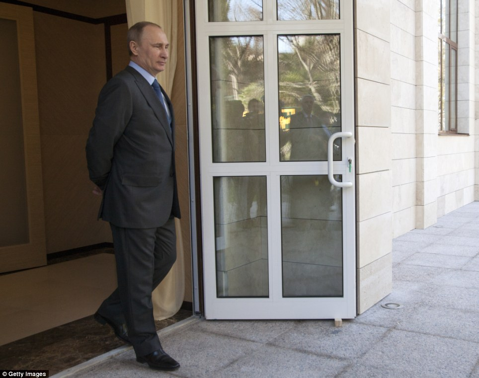 The man in charge: Russian President Vladimir Putin awaits the arrival of Turkish President Recep Tayyip Erdogan on Friday afternoon at his newly built Bocharov Ruchey state residence in Sochi