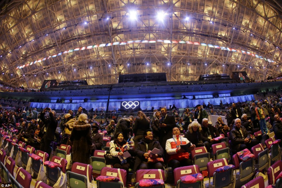 Fisheye in Fisht: In a photo taken with a fisheye lens, spectators arrive at the Fisht Olympic Stadium prior to the start of the opening ceremony of the 2014 Winter Olympics