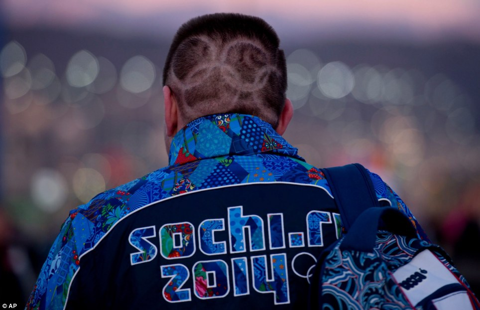 True dedication: A Canadian fan has got the Olympic rings shaved into his hair to show his love for the Winter Games which starts tonight