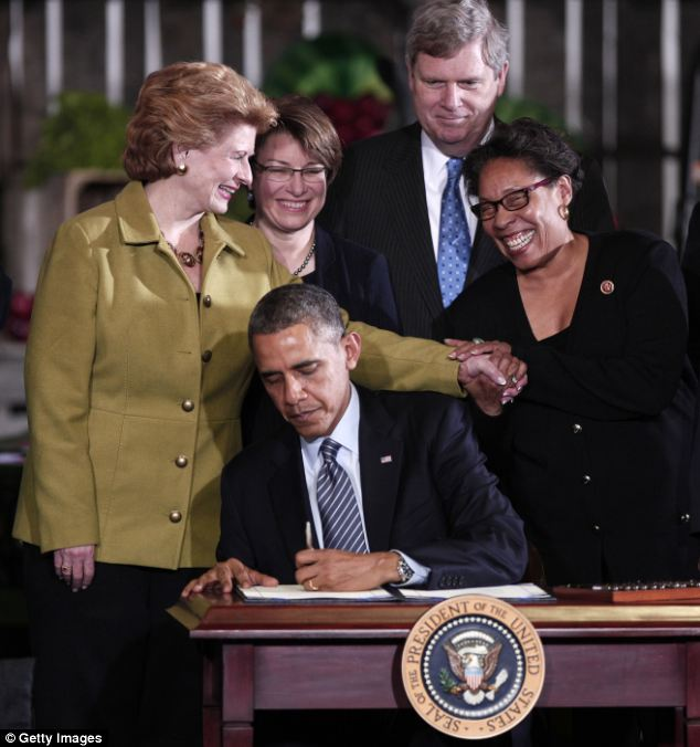 A table made from a pork barrel? Obama signed the nearly $1 trillion Farm Bill in Michigan on Friday
