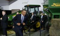 Back to Washington! Obama signed the Farm Bill in front of John Deere tractors, representing the big agribusinesses that will largely benefit from the new spending law