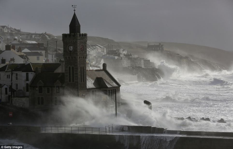 High tide storm waves break at Porthleven. Britain is bracing itself for more storms and spells of rain over the weekend