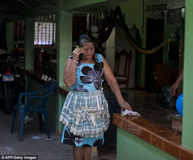 Maria Julia Alvarenga, mother of Jose Salvador Alvarenga, prepares to receive him at her house in Garita Palmera, 118 km west of San Salvador